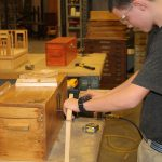 Carpentry student working in shop